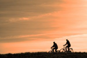 Two people on a bike ride